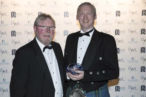 Walter Campbell of Glenshee Craft Distillers receiving the Elevator & Business Gateway Most Promising New Business Award from Andrew Burnett
