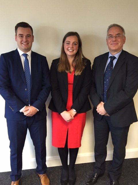 Trainees Rebecca Coltart and Adam Hoggan pictured with Chairman John Thom (right).